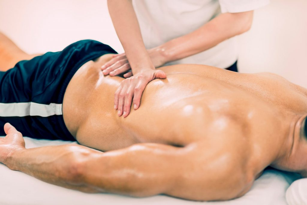 Physical therapist doing massage of lower back