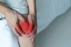 Man suffering from joint pain in knee