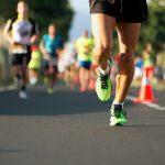 Male runner's feet participating in marathon