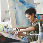 Woman painting in an art studio